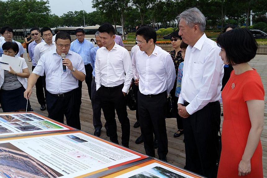 From right: Senior Parliamentary Secretary Sun Xueling, Deputy Prime Minister Teo Chee Hean, National Development Minister Lawrence Wong and Senior Parliamentary Secretary Baey Yam Keng touring the Sino-Singapore Tianjin Eco-city yesterday, where the