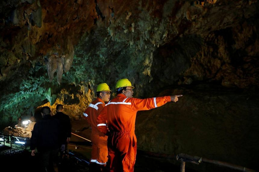Soldiers and rescue workers in the Tham Luang cave complex on July 1, 2018, as a search for members of an under-16 soccer team and their coach continues in the northern province of Chiang Rai, Thailand.