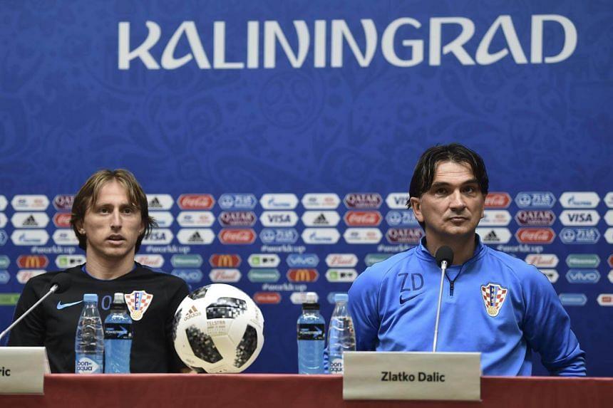 Croatia's midfielder Luka Modric (left) and Croatia's coach Zlatko Dalic attend a press conference in Kaliningrad on June 15, 2018.