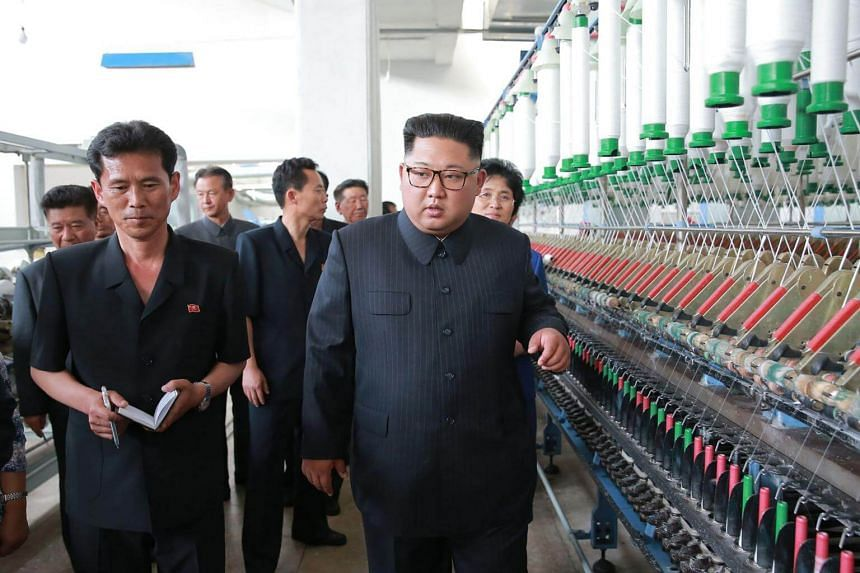 North Korean leader Kim Jong Un visiting the Sinuiju Textile Mill, where he chastened workers for not working hard enough, in an undated picture from North Korea's official Korean Central News Agency, on July 2, 2018.