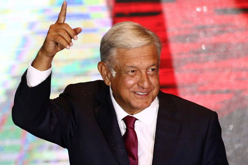 Presidential candidate Andres Manuel Lopez Obrador gestures as he addresses supporters after polls closed in the presidential election, in Mexico City, Mexico, on July 1, 2018.