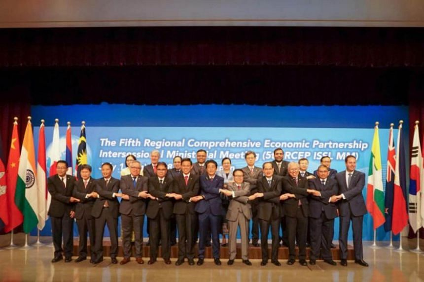 Trade ministers or representatives, including Singapore's Minister for Trade and Industry Chan Chun Sing (front row, sixth from left), from 16 countries gathering on Sunday (July 1) in Tokyo for the Fifth Regional Comprehensive Economic Partnership