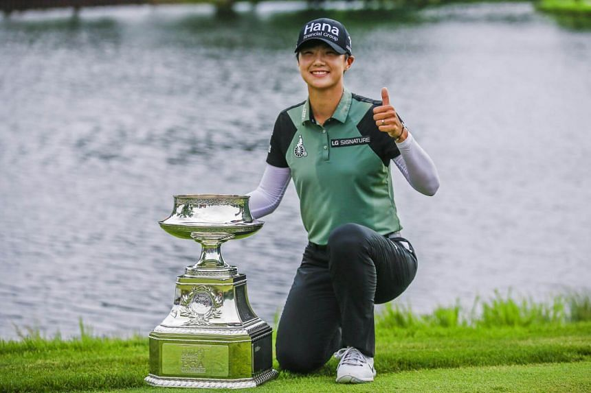 Park Sung Hyun poses with the Women's PGA Championship Trophy after winning in a playoff round of the Women's PGA Championship at Kemper Lakes Golf Club in Kildeer, Illinois, on July 1, 2018.