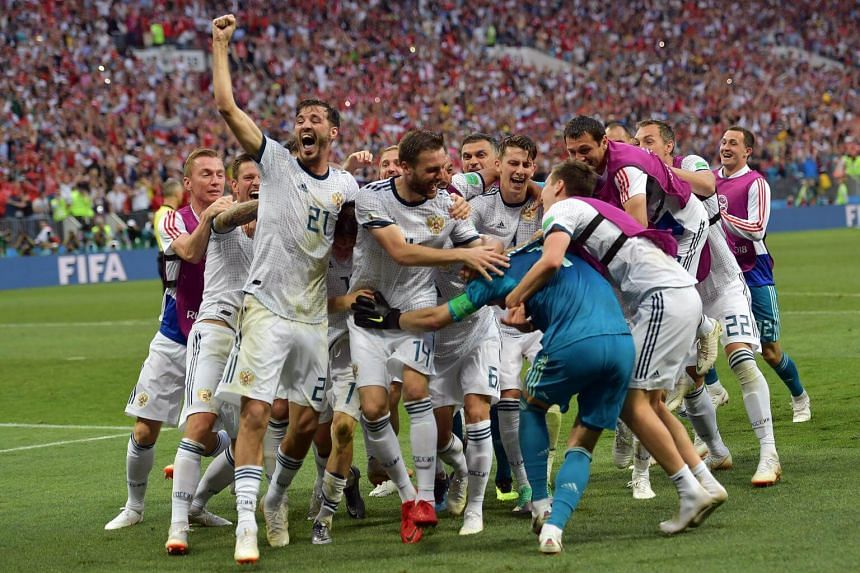 Russia players react after winning the FIFA World Cup 2018 round of 16 soccer match between Spain and Russia in Moscow on July 1, 2018.