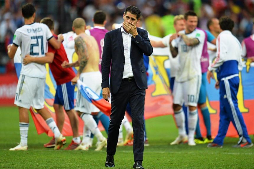 Spain's head coach Fernando Hierro (centre) reacts after the penalty shootout of the Fifa World Cup 2018 round of 16 soccer match between Spain and Russia in Moscow, Russia, on July 1, 2018.