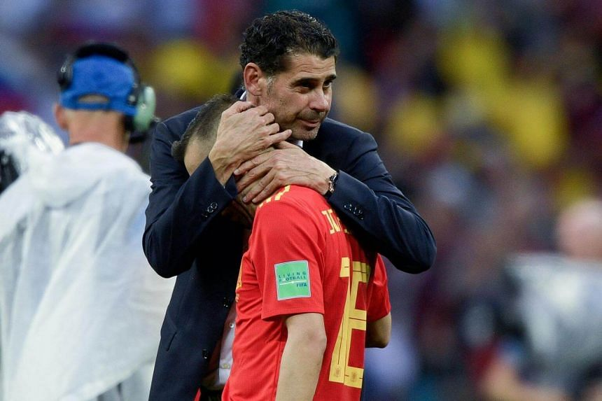 Spain's coach Fernando Hierro comforts Spain's defender Jordi Alba after losing the penalty shootout at the end of the match between Spain and Russia at the Luzhniki Stadium in Moscow on July 1, 2018.