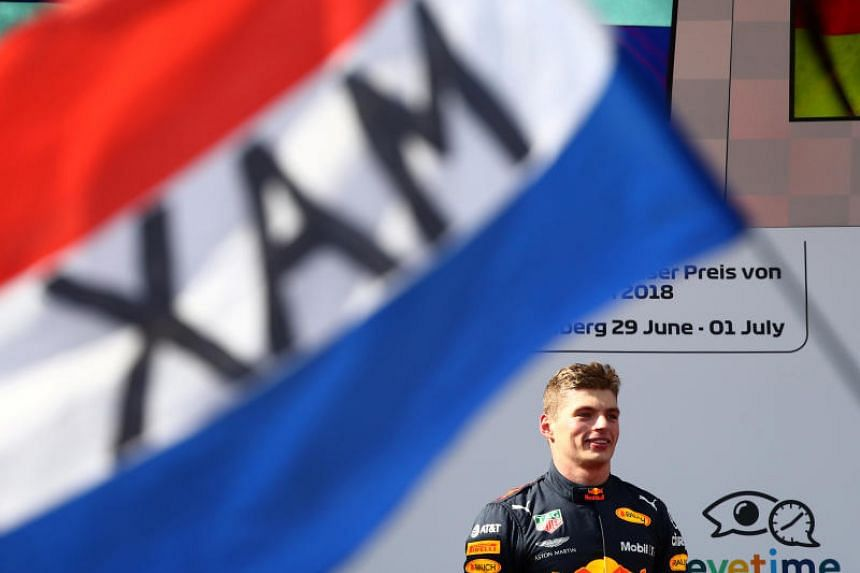 Red Bull's Max Verstappen celebrates on the podium after winning the race at the Red Bull Ring, Spielberg, Austria, on July 1, 2018.