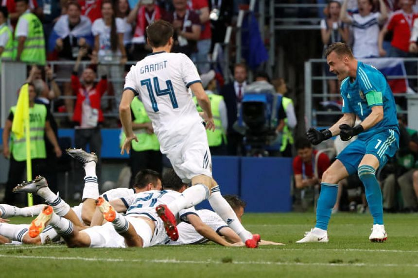 Russia's Igor Akinfeev celebrates with team mates after winning the penalty shootout at the Luzhniki Stadium, Moscow, Russia, on July 1, 2018.
