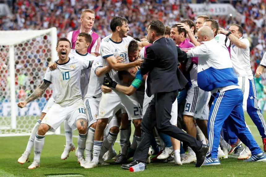 Russia players celebrate winning the penalty shootout at the Luzhniki Stadium, Moscow, Russia, on July 1, 2018.