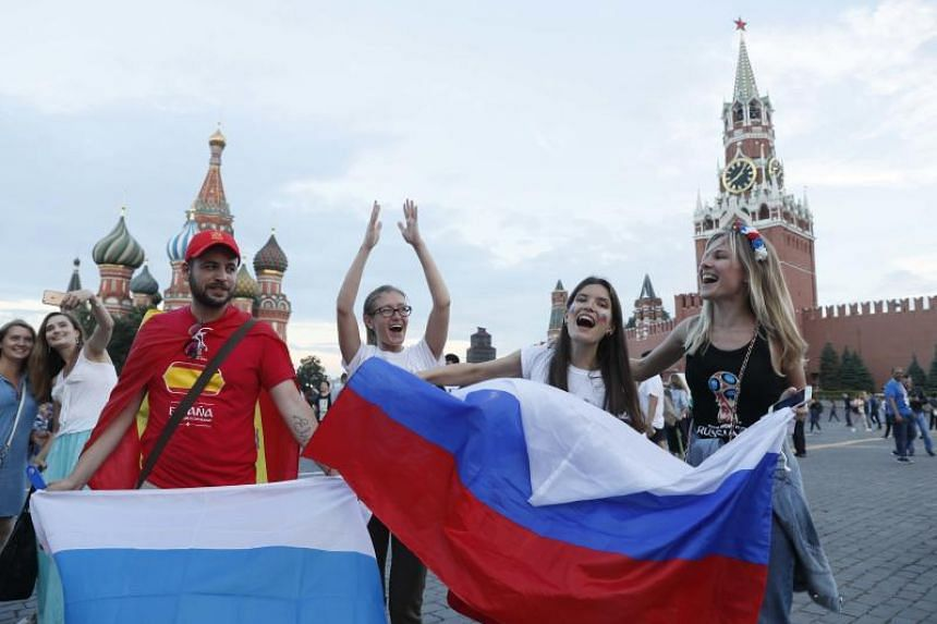 Russian supporters celebrate the victory in Red Square in Moscow, Russia, on July 1, 2018.