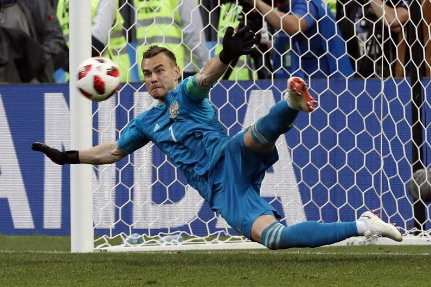 Goalkeeper Igor Akinfeev of Russia saves the last penalty during the penalty shootout of the Fifa World Cup 2018 round of 16 soccer match between Spain and Russia in Moscow, Russia, on July 1, 2018.