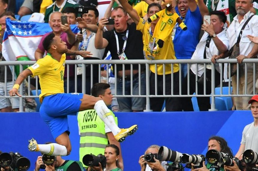 Brazil's forward Neymar celebrates after scoring the opening goal during the Russia 2018 World Cup round of 16 football match between Brazil and Mexico at the Samara Arena in Samara on July 2, 2018.