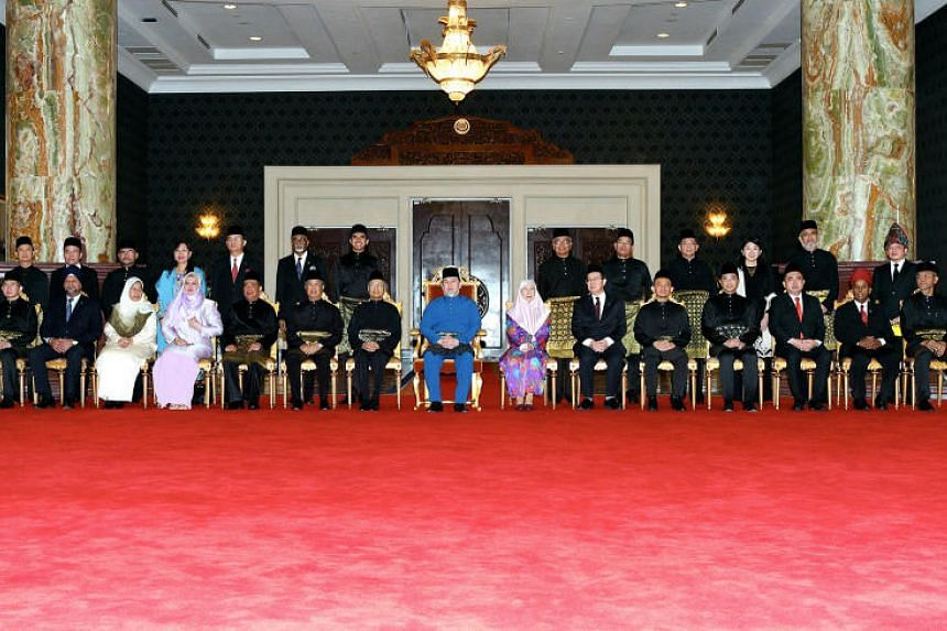 Malaysia's king, Sultan Muhammad V of Kelantan (centre), with the 13 ministers and 23 deputy ministers who were sworn in on July 2, 2018.