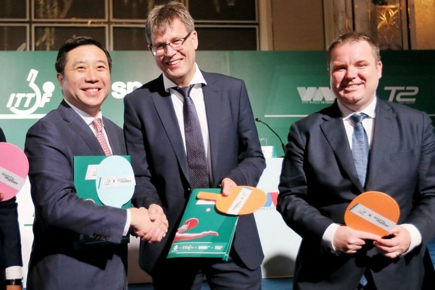 (From left to right) Frank Ji, Sportsmaster Founder, Thomas Weikert, ITTF President and Steve Dainton, ITTF CEO, posing for a picture after signing an agreement to set up a new professional table tennis platform for tournaments.
