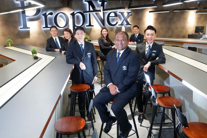 Mr Ismail Gafoor (in front), chief executive of PropNex, with his management team.