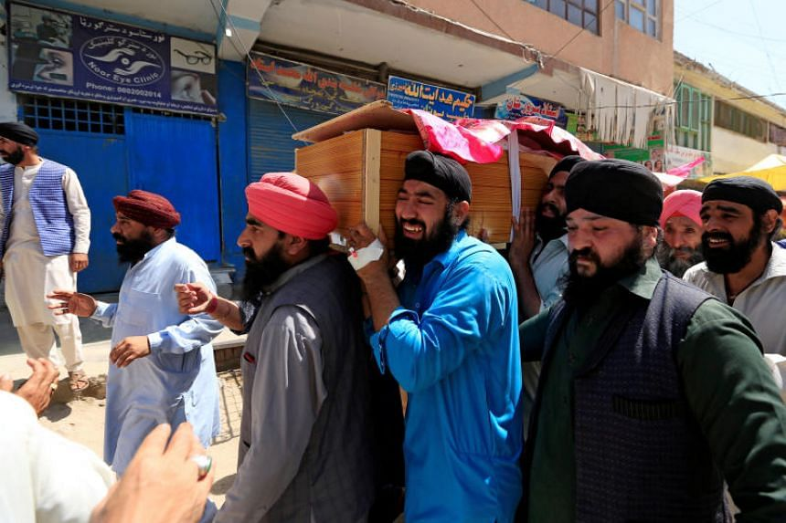 Afghan Sikh men carry the coffin of one of the victims of the July 1 blast in Jalalabad city, Afghanistan, on July 2, 2018.