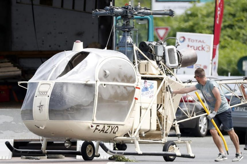 Investigators transport an Alouette II helicopter allegedly abandoned by French prisoner Redoine Faid and suspected accomplices after his escape from the prison of Reau, France, on July 1, 2018.