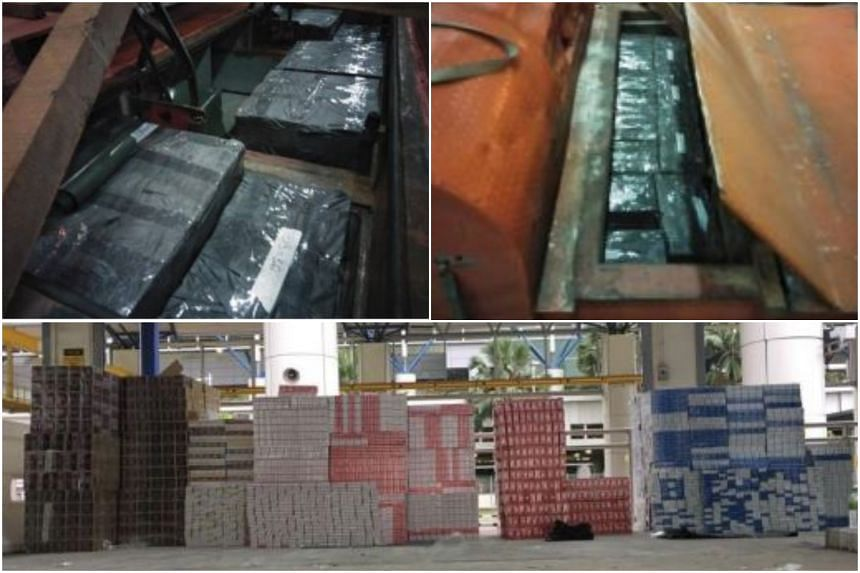 The cartons were found concealed beneath the vehicles' floorboards.