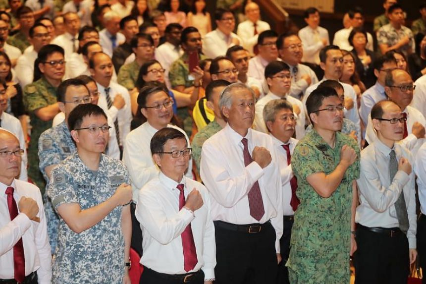 Defence Minister Ng Eng Hen (third from right) at the annual SAF Day Combined Rededication Ceremony at Jurong Town Hall on July 2, 2018.