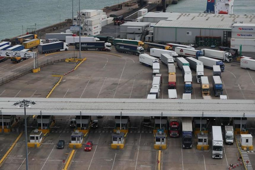 Cargo lorries pass through the ferry check-in kiosks at the Port of Dover on the south coast of England, on March 19, 2018.