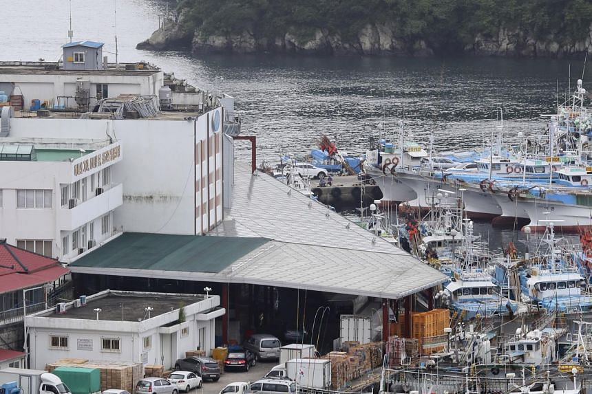Fishing vessels moored at a port in Seogwipo, on South Korea's Jeju island on July 2, 2018, as weather authorities issued high-wave warnings for the island due to Typhoon Prapiroon.