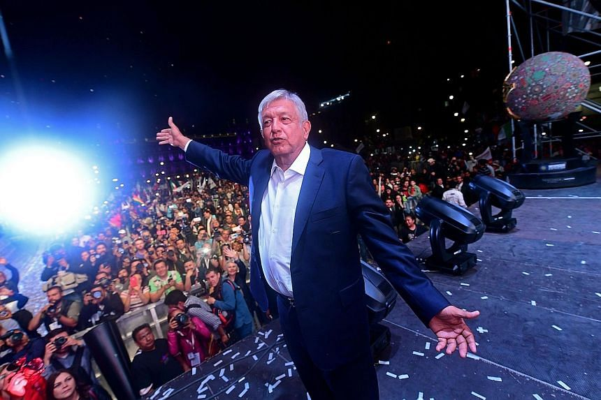 Mr Andres Manuel Lopez Obrador with his supporters at Mexico City's Zocalo Square after his victory.