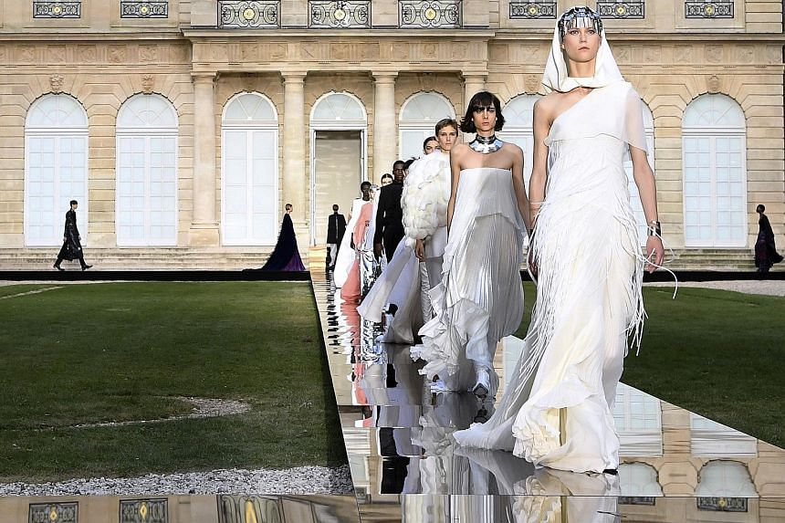 The haute couture show by Givenchy (above and below) was held in the gardens of the National Archives in Paris' Marais district.