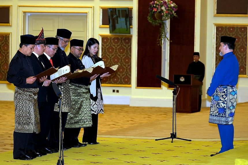 Swearing in before the Malaysian King are (from left) Tourism, Arts and Culture Minister Mohamaddin Ketapi; International Trade and Industry Minister Ignatius Darell Leiking; Minister in the Prime Minister's Department (Law) Liew Vui Keong; Federal T