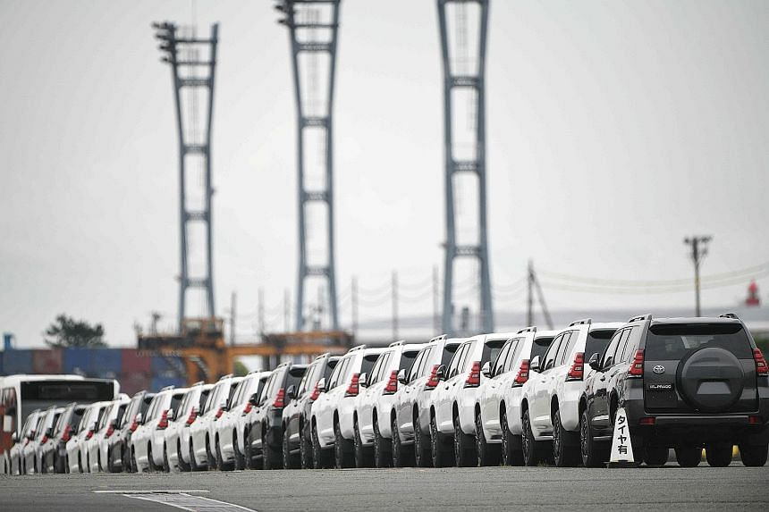 Cars at a pier in Yokohama. Industrial sectors such as cars and oil weighed on overall business sentiment, fanning fears that US President Donald Trump may target auto imports from Japan and other trading partners for protectionist tariffs after impo