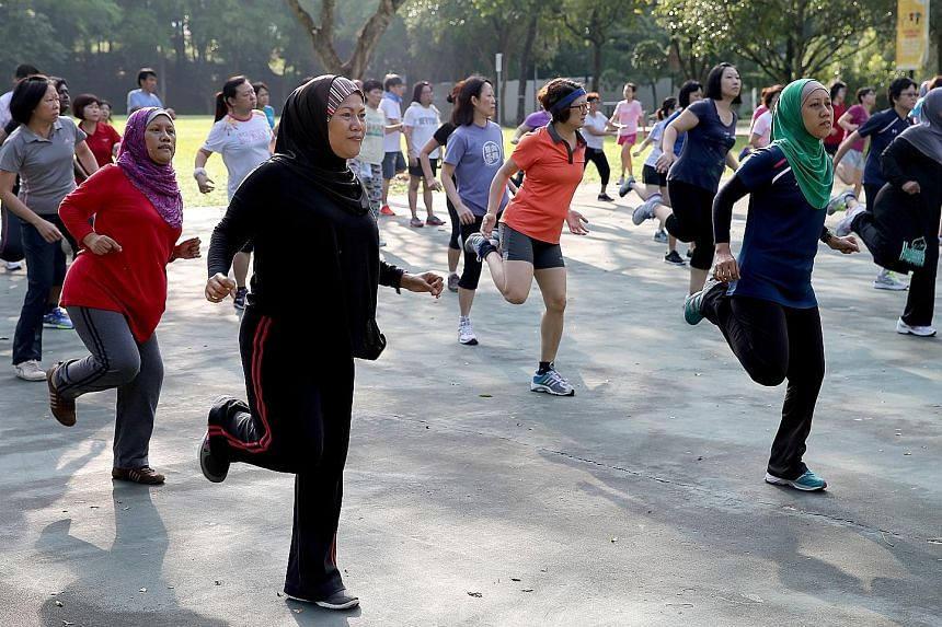 Residents participating in a Bokwa Fitness routine in Choa Chu Kang Park. The lack of physical activity remains a key health issue here as almost 40 per cent of Singaporeans do not get sufficient physical activity, according to the Health Promotion B