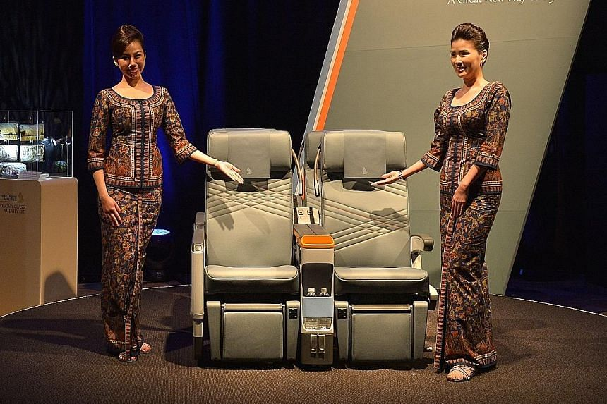 SIA unveiling its premium economy class products in 2015. Recent studies have shown that it is economy travellers, especially those on work trips, who have moved up, putting to rest fears that the new offering would cannibalise the premium market.