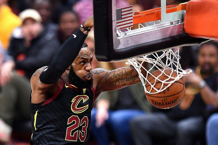 LeBron James dunking for the Cleveland Cavaliers during his side's loss to the Golden State Warriors in the NBA Finals last month. James will now be playing in the Western Conference, alongside the Warriors and the conference runners-up Houston Rocke
