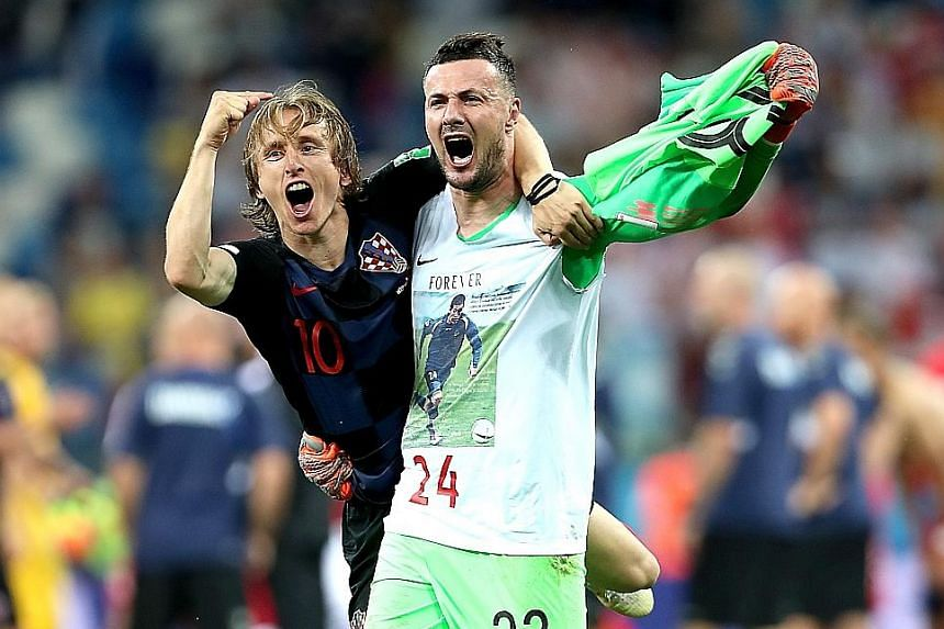 Captain Luka Modric celebrating with goalkeeper Danijel Subasic after Croatia overcame Denmark 3-2 on penalties in the World Cup round of 16.