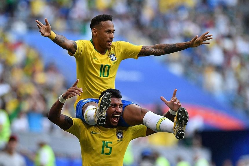 Neymar getting a piggyback ride from Paulinho after opening the scoring against Mexico in their last-16 match. Brazil's No. 10 also set up substitute Roberto Firmino for a late strike to seal the five-time winners' 2-0 triumph and passage into the qu