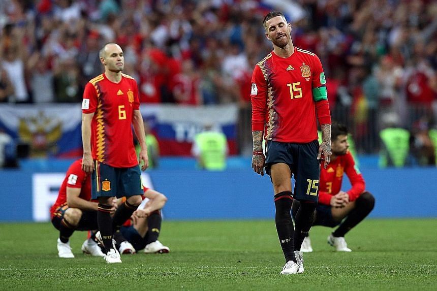 Captain Sergio Ramos and Andres Iniesta are crestfallen after Spain lose the penalty shoot-out to Russia at the Luzhniki Stadium in Moscow.