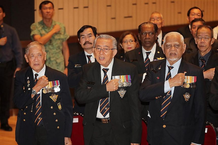 SAF veterans reciting the SAF Pledge during the SAF Day Combined Rededication Ceremony. There were four such ceremonies held around the island yesterday.