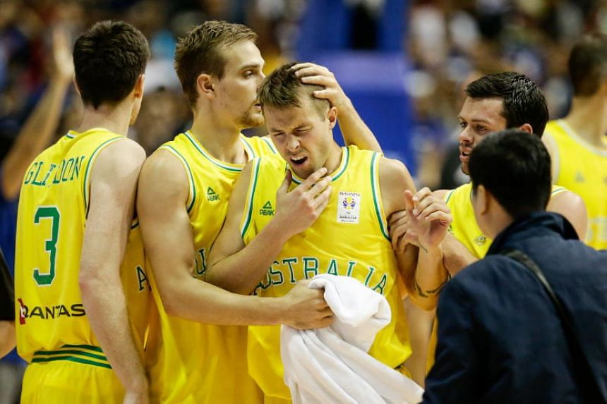 Nathan Sobey (centre) of Australia reacts after getting into a brawl with players from the Philippines during the FIBA Basketball World Cup 2019 Group B qualifier match between the Philippines and Australia in Manila on July 2, 2018.
