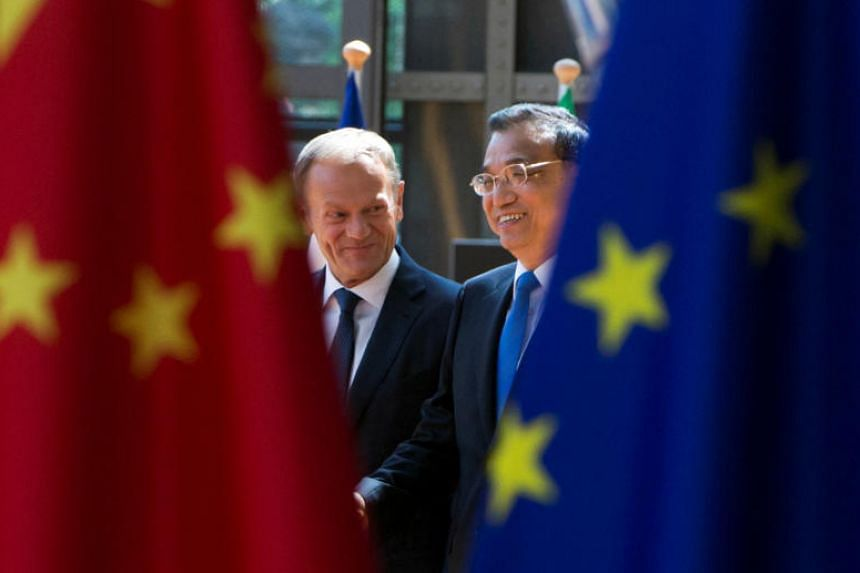 European Council President Donald Tusk and Chinese Premier Li Keqiang (right) arrive to attend an EU-China Summit in Brussels, Belgium, on June 2, 2017.