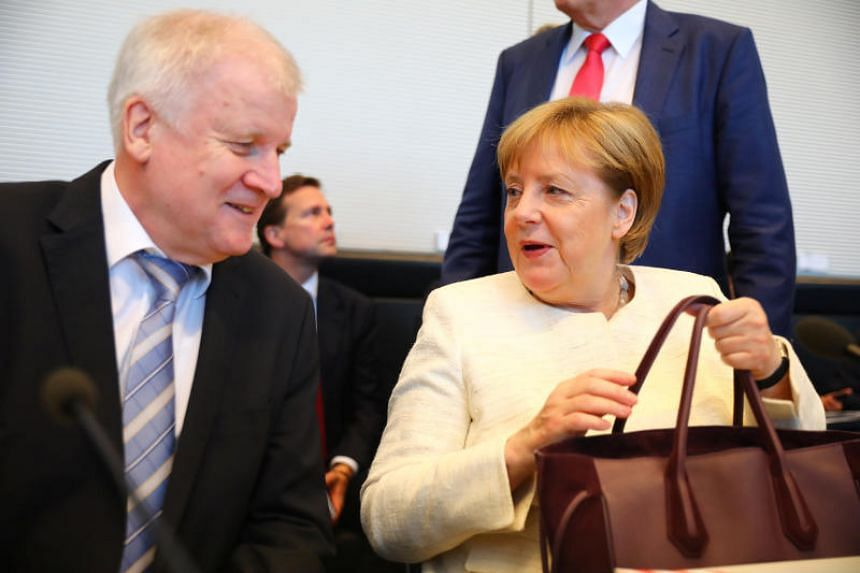 German Chancellor Angela Merkel (right) reached a compromise deal on July 2, 2018, on migration with her rebellious interior minister, Horst Seehofer, to defuse a bitter row that had threatened her government.