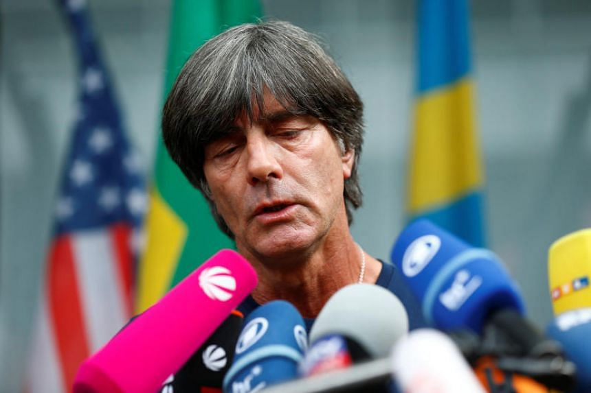 Joachim Low returned from Russia considering his future, but the German Football Association said they would not sack him.