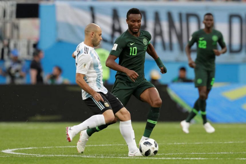 Argentina's Javier Mascherano and Nigeria's John Obi Mikel in action during their World Cup Group D match on June 26, 2018.