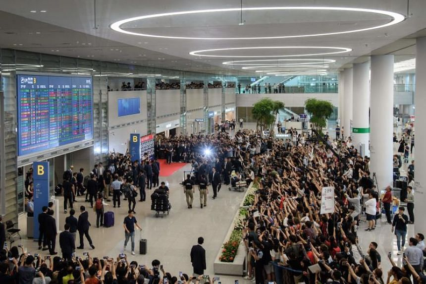 South Korea's World Cup football squad arrive at Incheon international airport on June 29, 2018 after competing in the 2018 Russian World Cup.