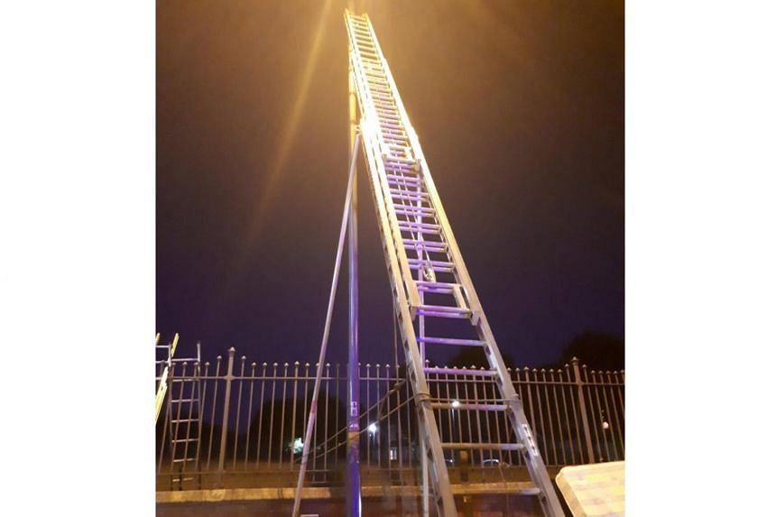 """Fire crews and ambulance personnel brought the man down using a hydraulic platform, with the West Midlands Fire Service tweeting that the incident """"could have ended very differently""""."""