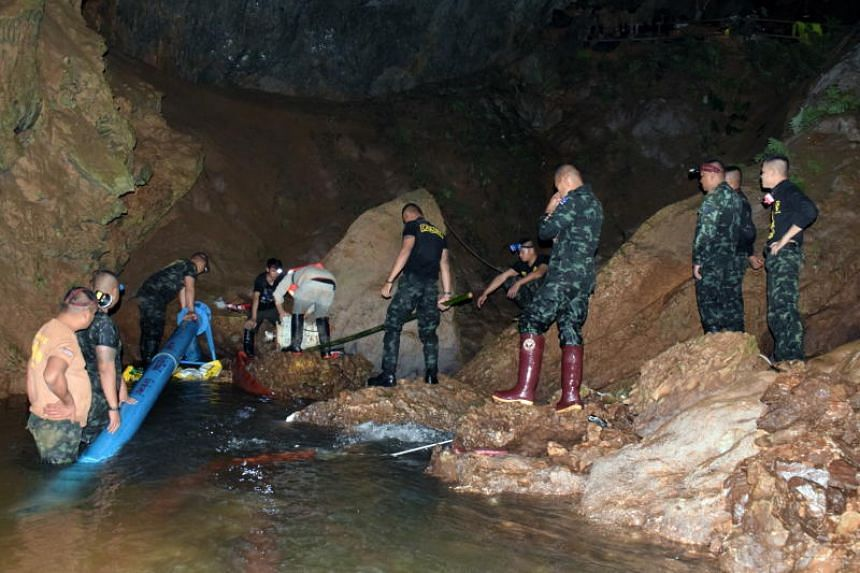 Thai soldiers pumping flooded water out of the cave complex during a rescue operation for a missing youth soccer team and their coach at Tham Luang cave in Thailand.