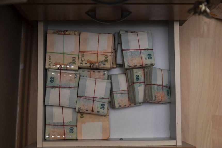 About $1.25 million in cash were seized and 31 men arrested during a police operation on illegal football betting on July 2, 2018.