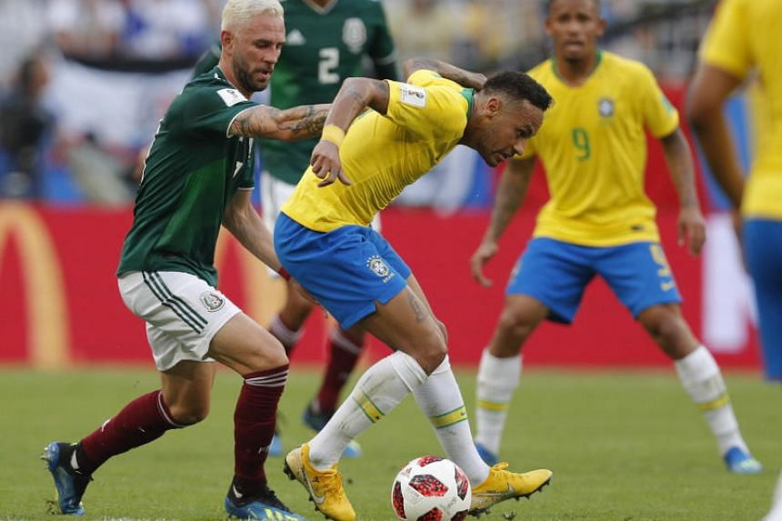 Neymar (right) of Brazil and Miguel Layun of Mexico in action during the Fifa World Cup 2018 round of 16 soccer match between Brazil and Mexico in Samara, Russia, on July 2, 2018.