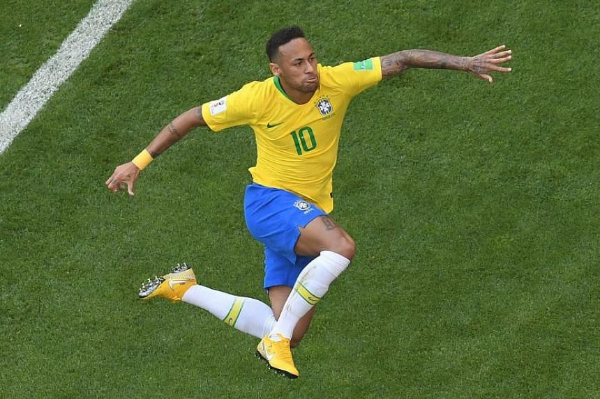 Brazil's forward Neymar celebrates scoring the opening goal during the Russia 2018 World Cup round of 16 football match between Brazil and Mexico at the Samara Arena in Samara on July 2, 2018.