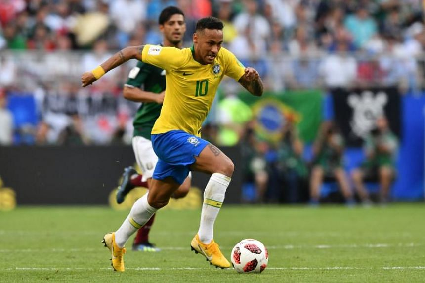 Brazil's forward Neymar runs with the ball during the Russia 2018 World Cup round of 16 football match between Brazil and Mexico at the Samara Arena in Samara on July 2, 2018.