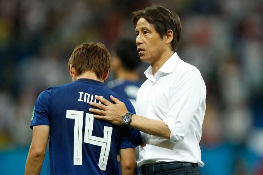 Japan's midfielder Takashi Inui is comforted by Japan's coach Akira Nishino (right) at the end of the Russia 2018 World Cup round of 16 football match between Belgium and Japan at the Rostov Arena in Rostov-On-Don, on July 2, 2018.