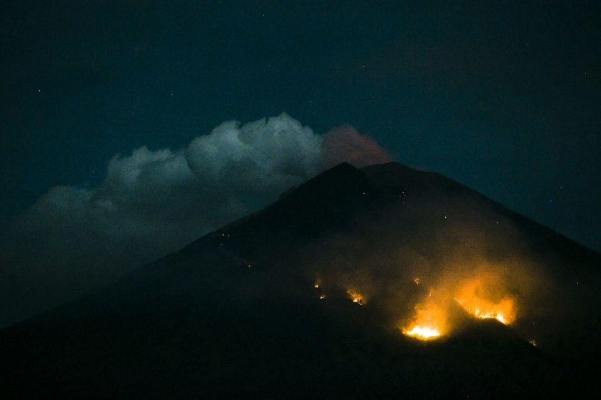 Forest fires on the slope of Mount Agung after an eruption, as seen from Amed Village in Karangasem, Bali, on July 2, 2018.
